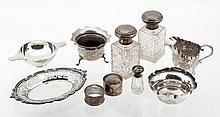 A collection of silver items, to include: a shaped oval dish by Charles...