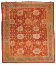 An Ushak Carpet , the umber field decorated with geometric motifs in pale