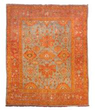 An Ushak carpet, the blue field and madder border decorated with geometric...