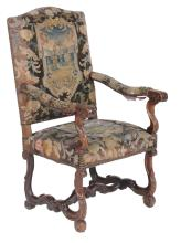 A Louis XV oak armchair , circa 1720, the rectangular back and seat covered...