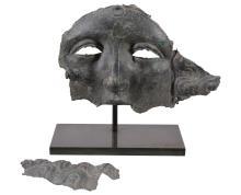 A fragmentary Roman bronze mask, circa 1st / 2nd century AD