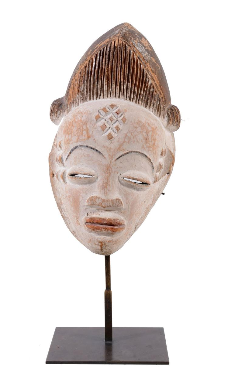 A punu Mask, Gabon, circa 1930, the elongated face with pointed chin