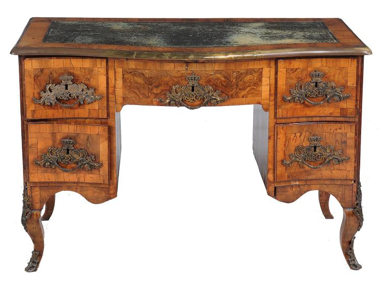 A South German walnut serpentine fronted desk , second quarter 18 th century