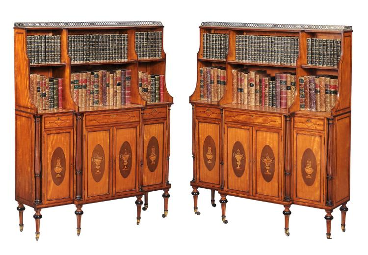 A pair of satinwood, crossbanded and marquetry decorated breakfront side...