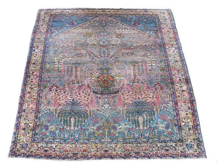 A Kashan carpet, the rose pink and ultramarine field centred by a flowering...