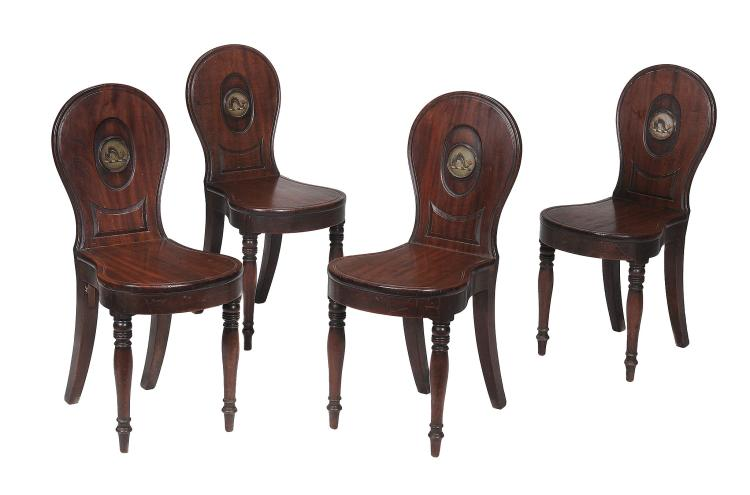 A set of four Regency mahogany hall chairs , circa 1815