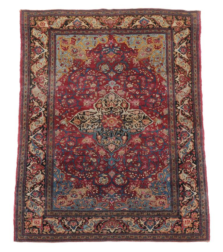An Esfehan rug , decorated throughout with floral branches