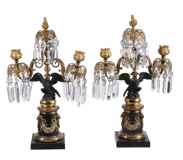 A pair of Regency gilt and patinated bronze twin light lustre candelabra