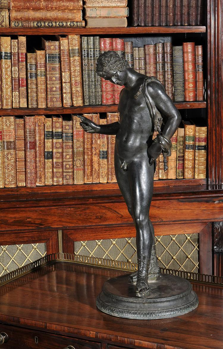 A Neapolitan patinated bronze model of Narcissus, cast after the Antique