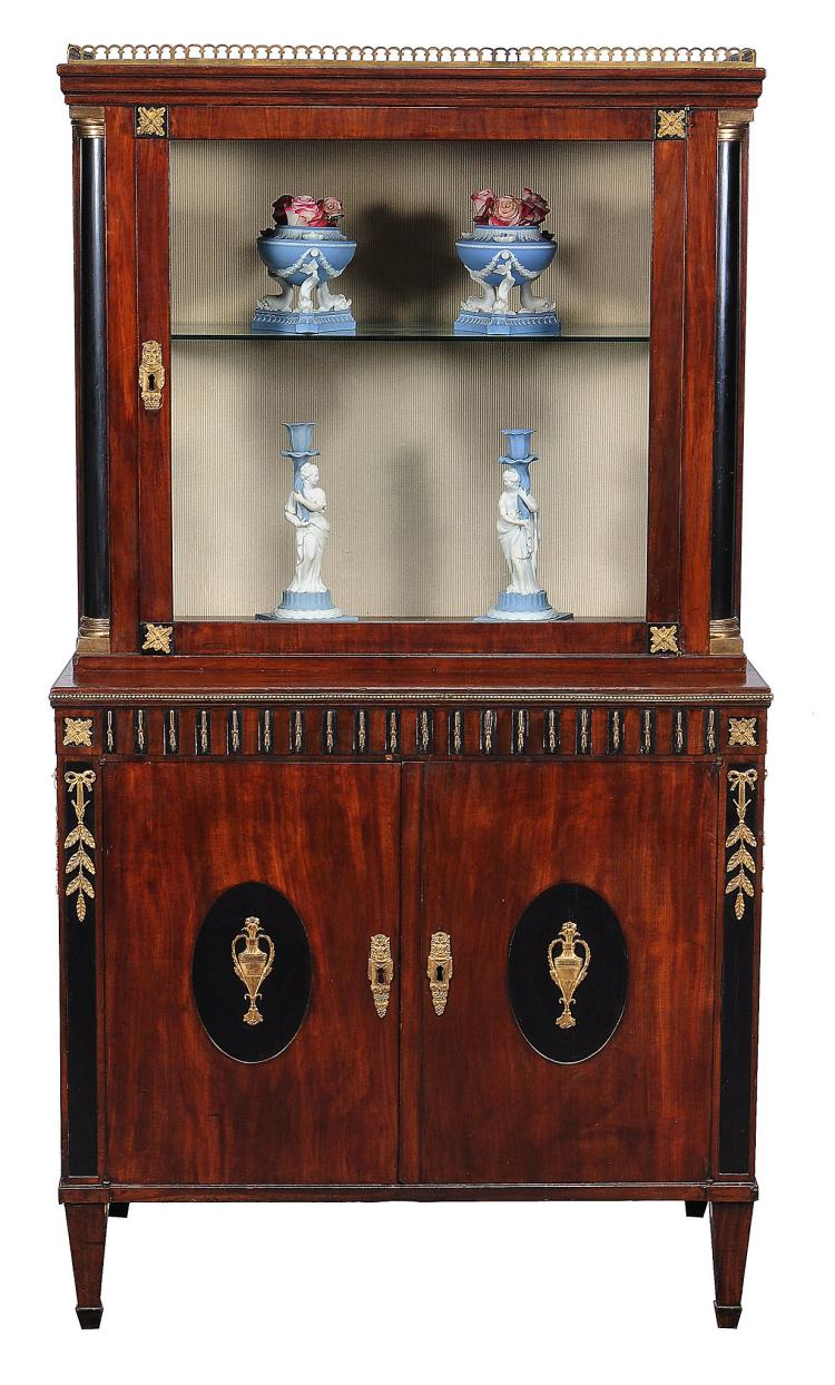 An Empire mahogany and ebonised gilt metal mounted cabinet, circa 1810