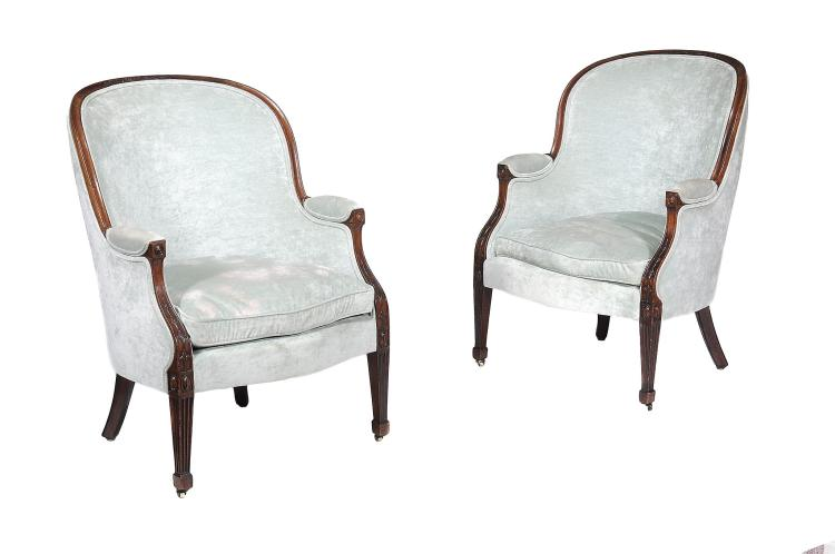 A pair of mahogany upholstered tub armchairs , circa 1810 and later