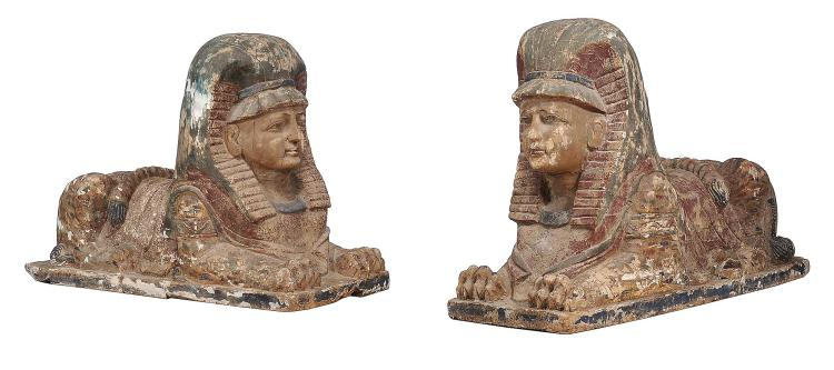 A pair of carved and polychrome painted wood models of recumbent sphinxes