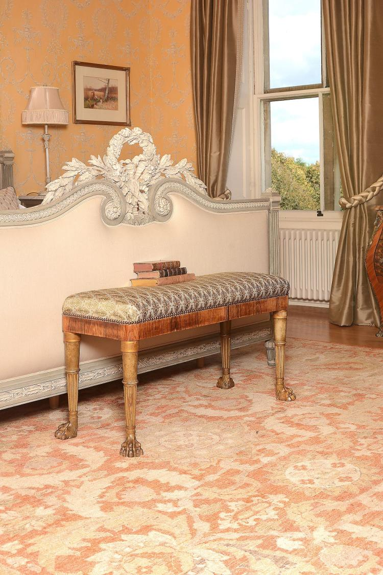 A Regency rosewood and parcel gilt window seat , circa 1815