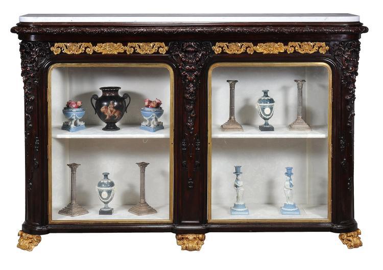 A Victorian mahogany and gilt metal mounted display cabinet, circa 1840