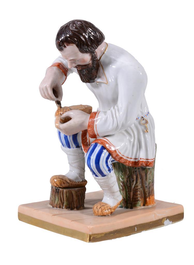 A Moscow porcelain figure of a cobbler, circa 1850