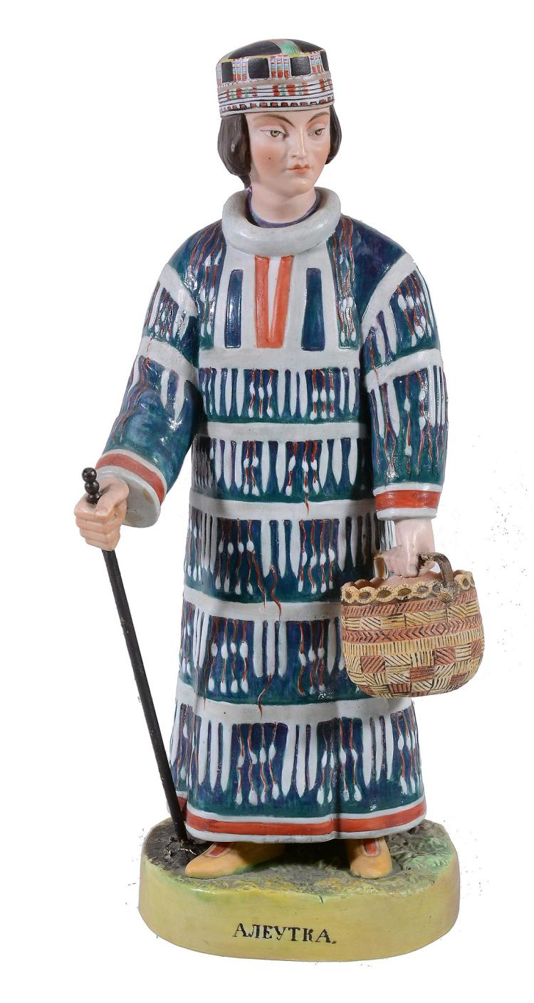 A Russian biscuit porcelain figure of a woman in native dress