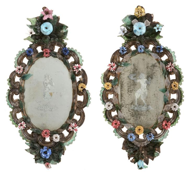 A pair of Venetian moulded and etched glass wall mirrors
