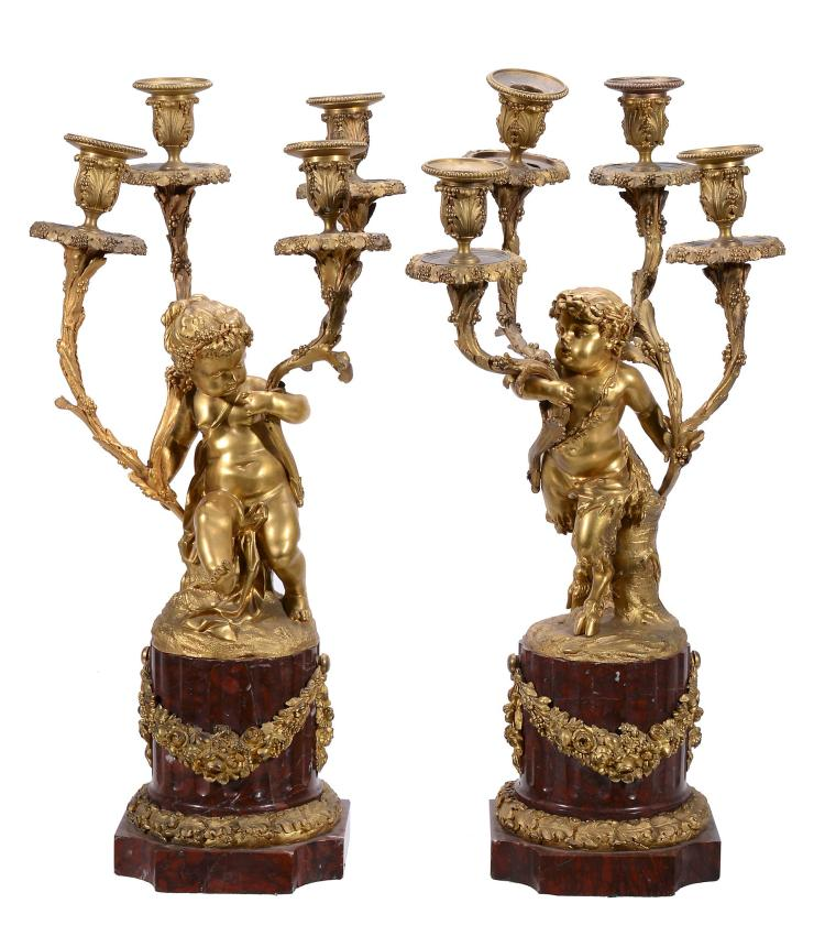 A pair of Napoleon III gilt bronze and marble mounted four light figural...