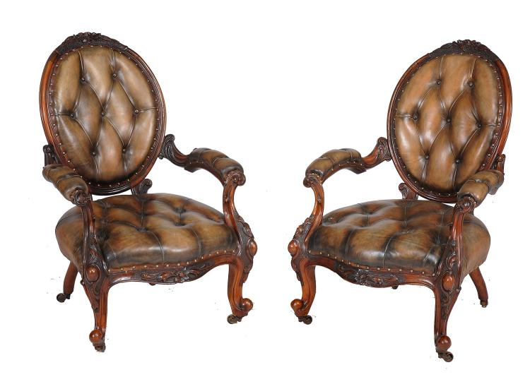 A pair of Victorian walnut and leather upholstered armchairs , circa 1870