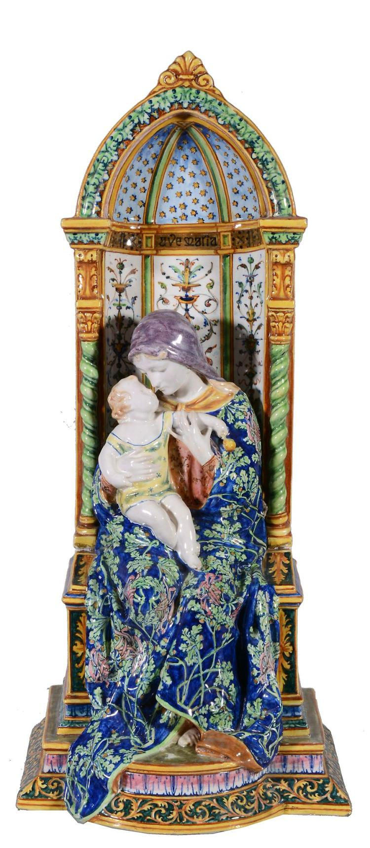 An Angelo Minghetti & Son maiolica model of the Madonna and Christ Child...