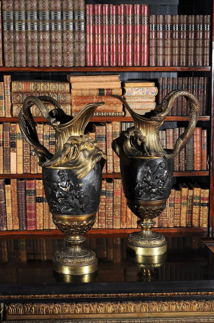 A pair of gilt and patinated bronze ewers in the manner of Clodion, circa 1880