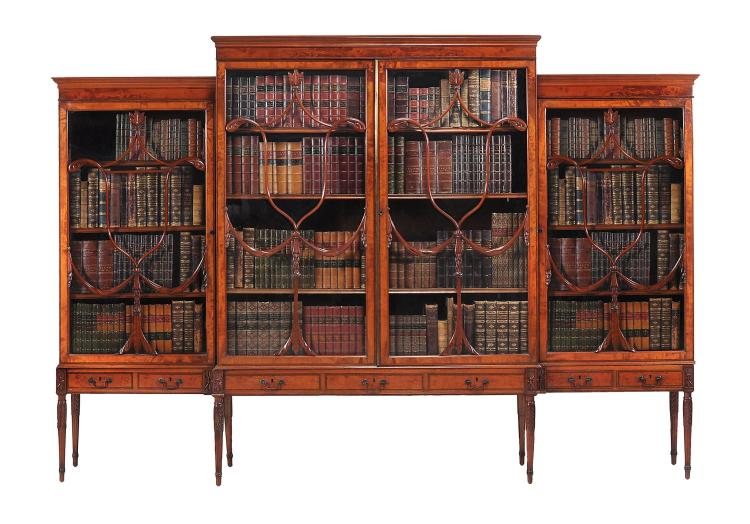 A Victorian satinwood breakfront bookcase or display cabinet