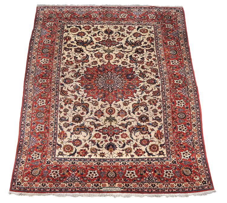 An Isfahan carpet, signed Seirafian, approximately 398 x 260cm