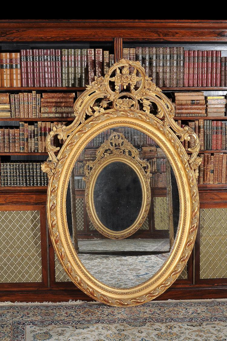 A Victorian giltwood and composition mirror , circa 1890, 176cm high, 107cm wide