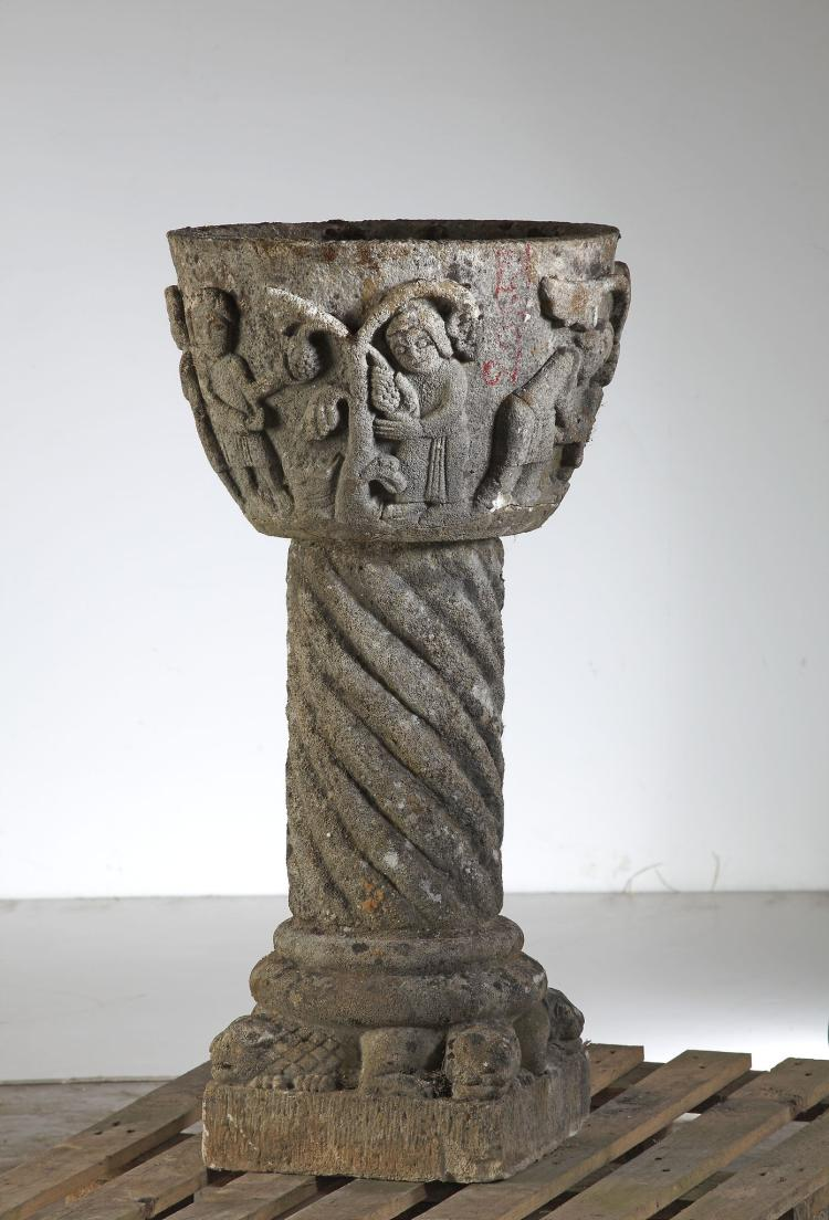 A carved limestone planter on plinth in the manner of roma