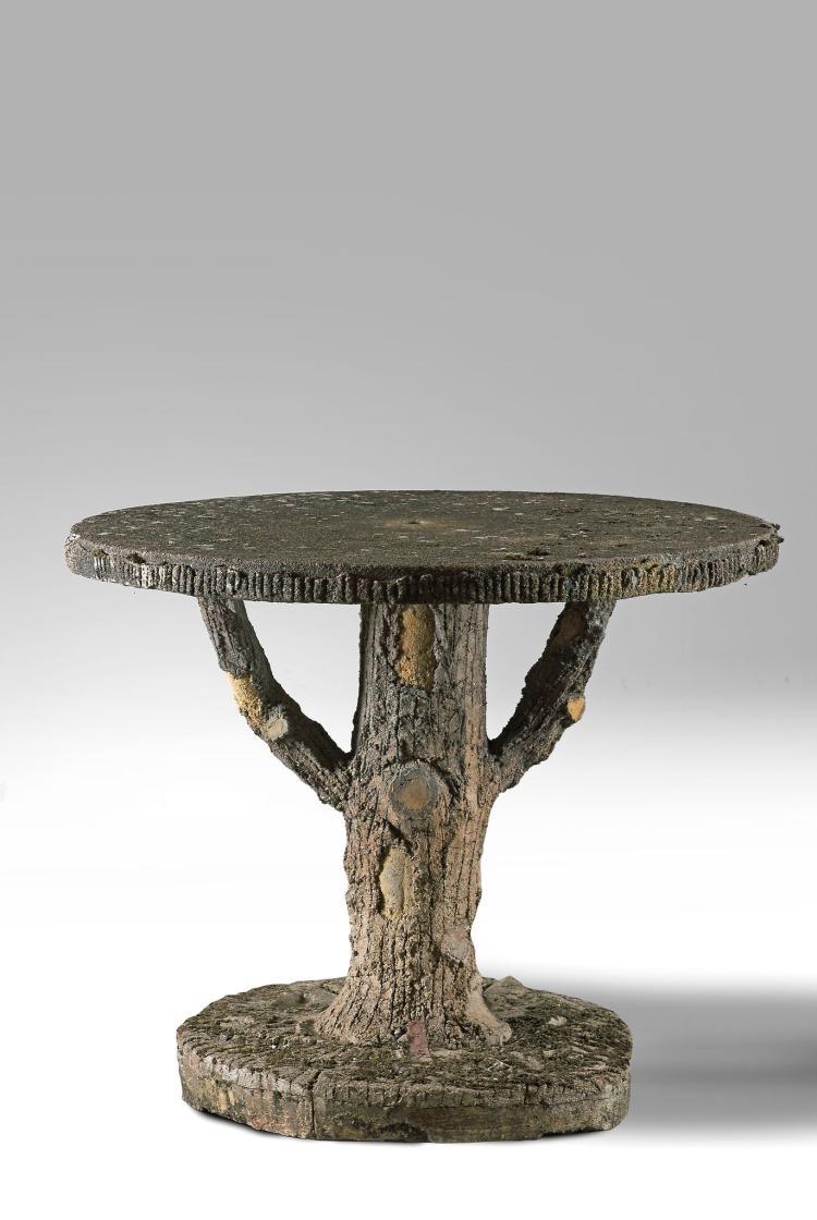 A stone composition faux bois garden table , late 19th centu