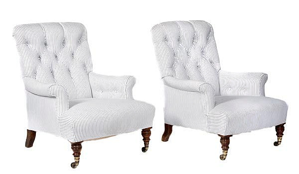 A pair of Victorian walnut and button upholstered