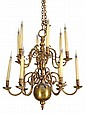 A brass twelve light chandelier in the late 17th