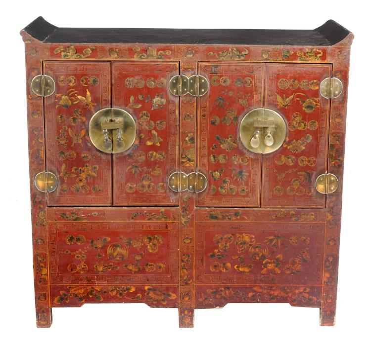 A Chinese red lacquer brass mounted cabinet, fitted with two pairs of doors
