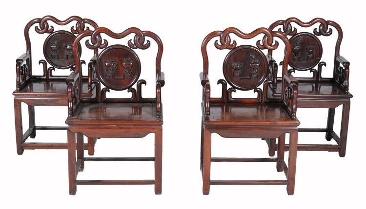 A set of four Chinese hardwood armchairs, late Qing Dynasty