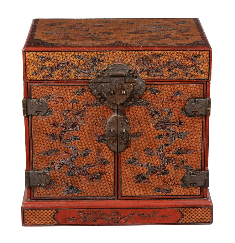 A Chinese orange and red qiangjin and tianqi type lacquer 'dragon' seal chest