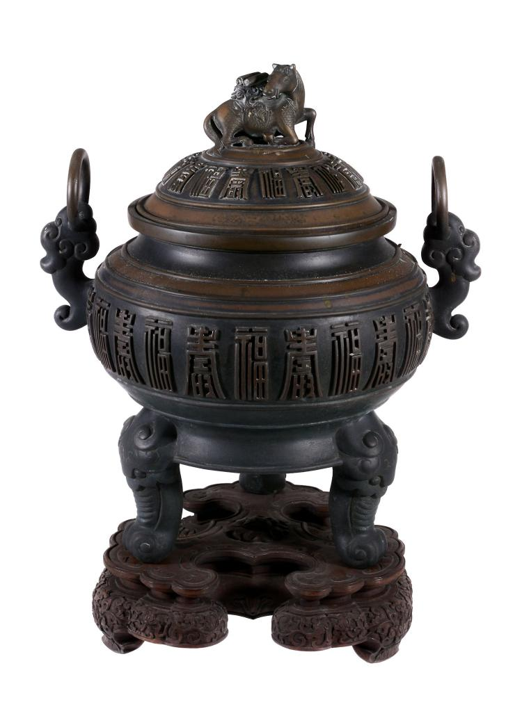A Chinese bronze vase and cover, late 19th century, with bands of shou symbols