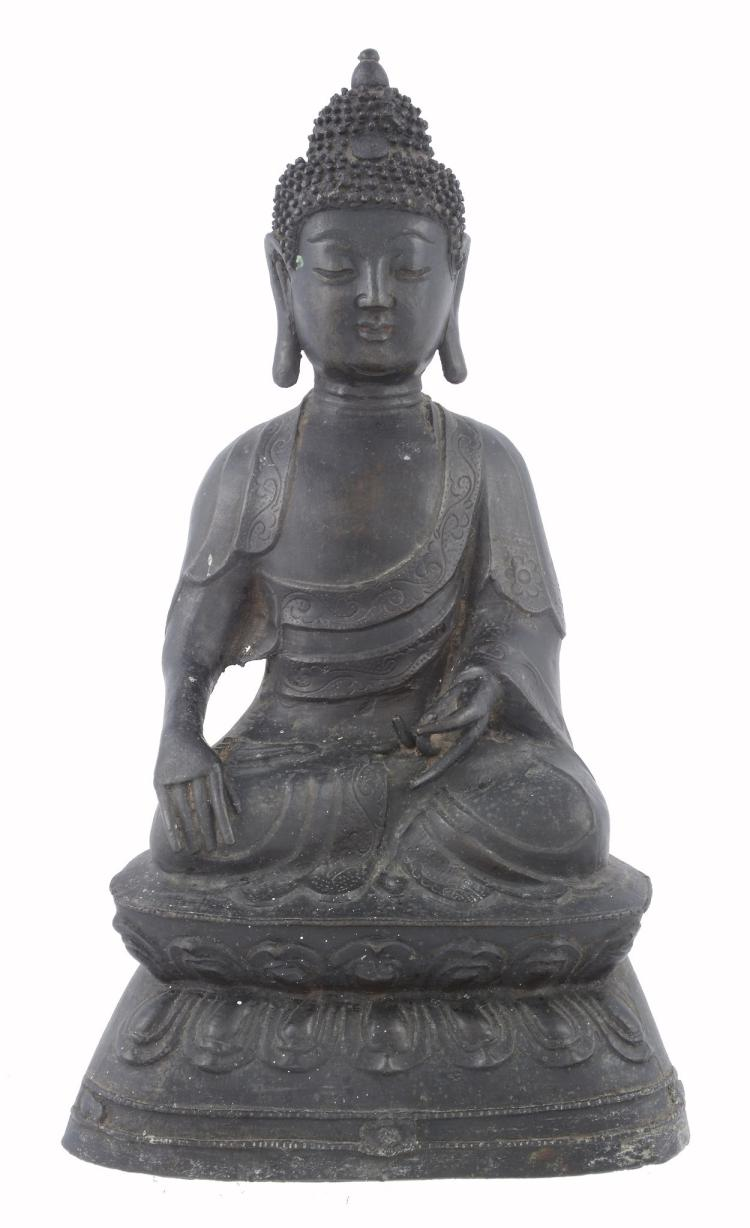 A Chinese bronze Buddha, late Qing Dynasty, seated on raised base