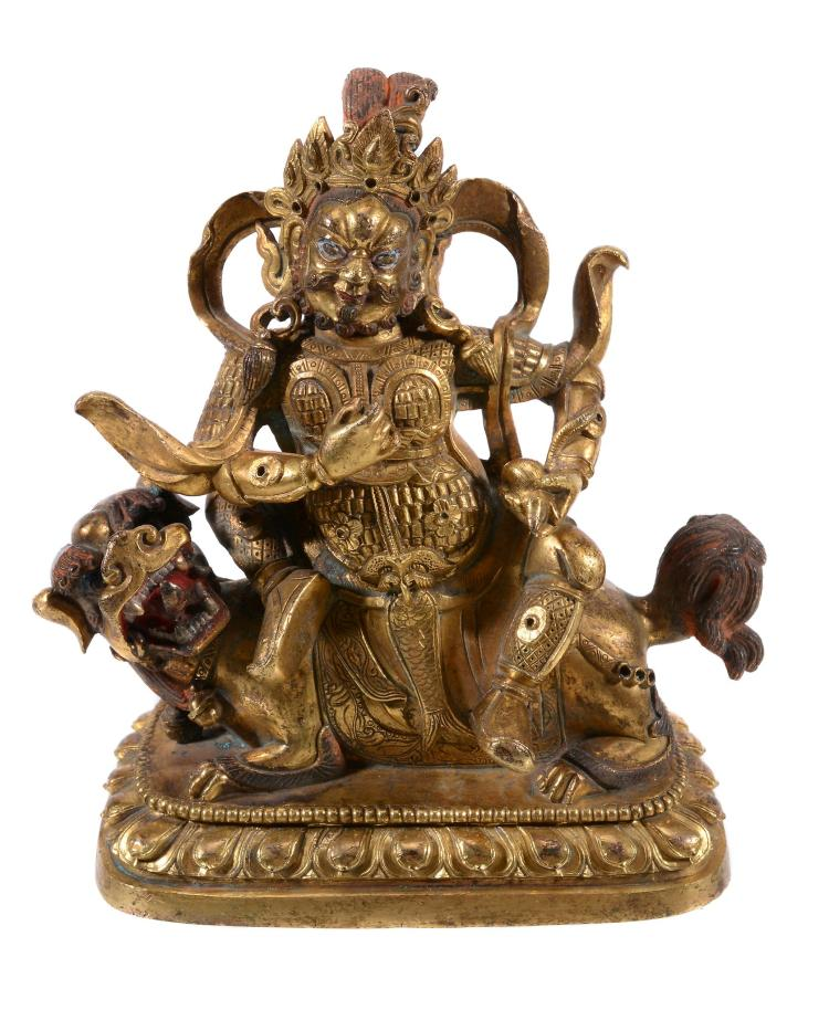 A Sino-Tibetan gilt bronze figure of Vaishravana