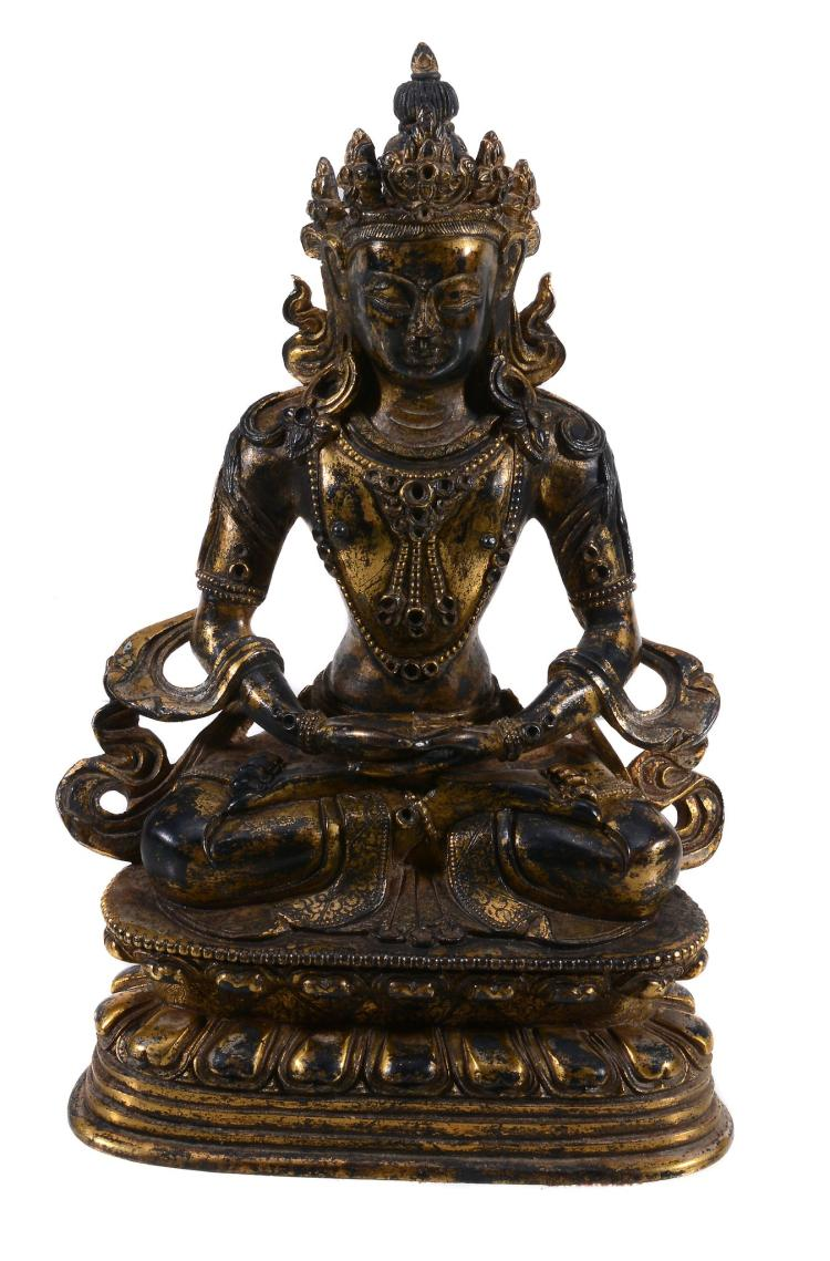 A Sino-Tibetan gilt bronze of Amitayus, cast seated in dhyanasana on a tall...