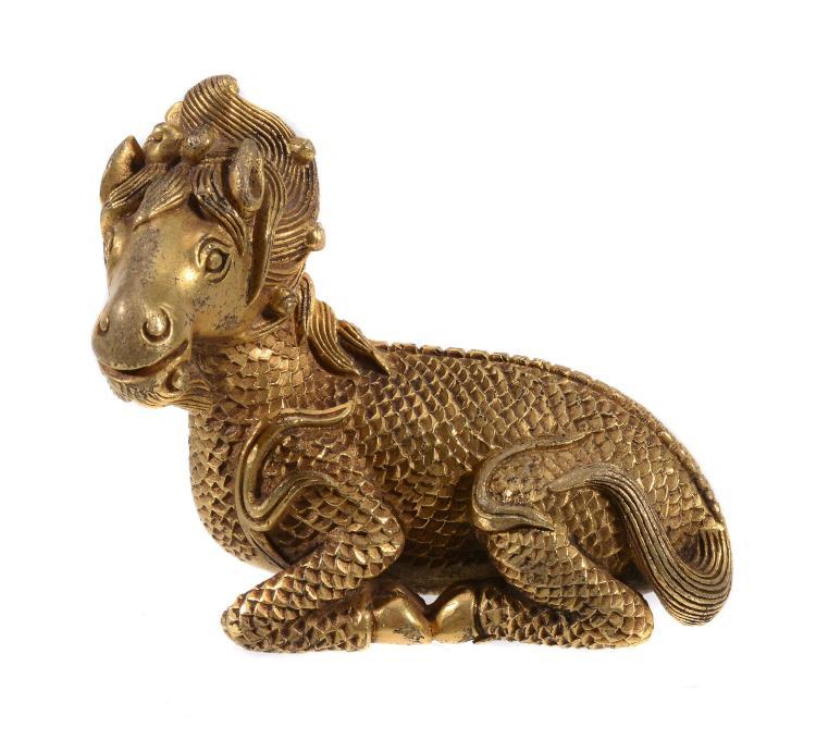 A Chinese gilt-bronze model of a 'ram' weight, well cast