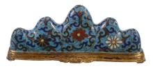 A Chinese cloisonné brush rest, depicting a stylised mountain