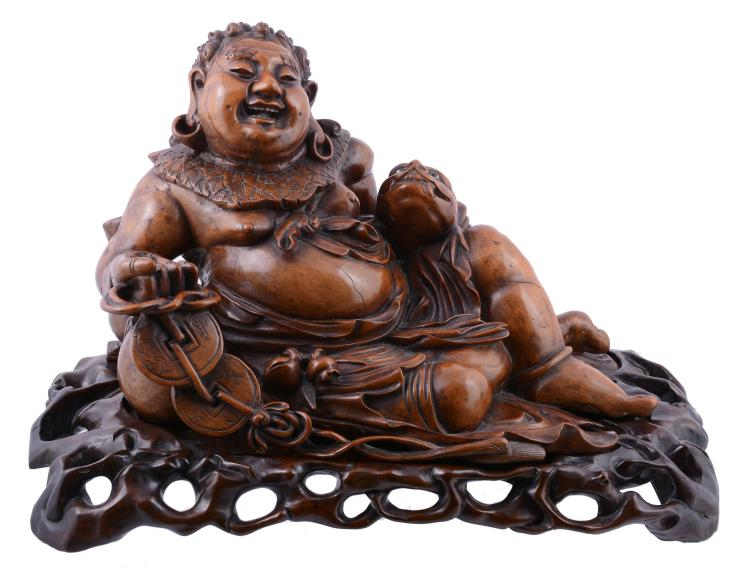 A Chinese hardwood figure of a laughing Buddha, late 19th or early 20th century