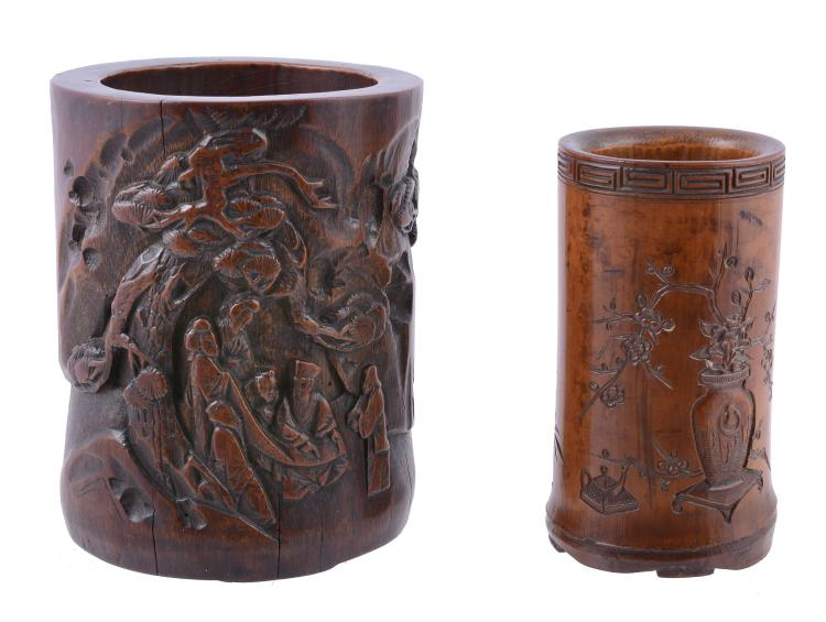 A Chinese bamboo brush pot, Qing Dynasty, carved with figures attending a...