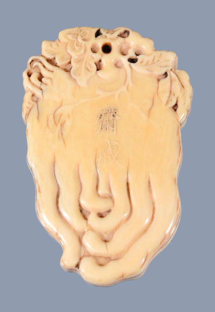 A Chinese ivory 'finger citrus' pendant, circa 1850-1900