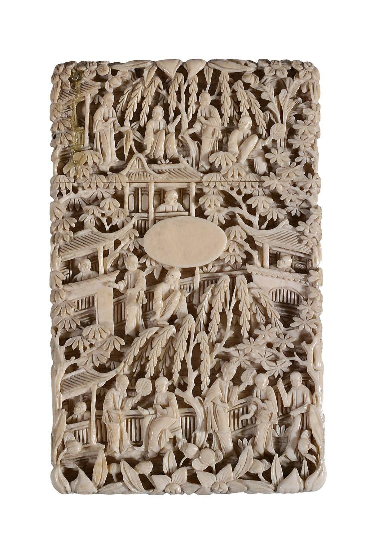 A Cantonese ivory card case, circa 1850, carved in high relief with figures...