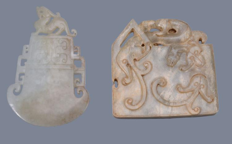 An Archaistic style pale celadon jade carving, in the form of a blade