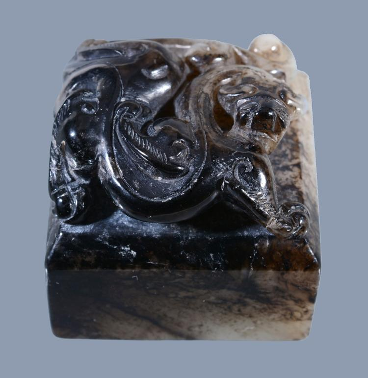 A Chinese celadon and black jade 'Dragon' seal, of square shape, 4.5cm x 4