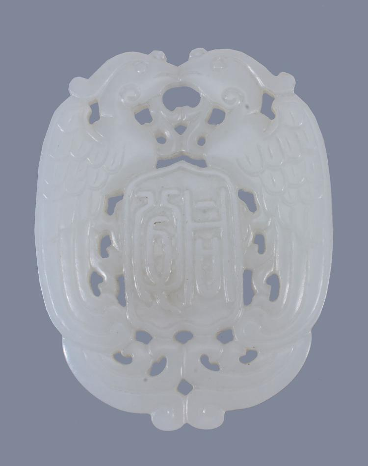 A Chinese white jade double 'Phoenix' pendant