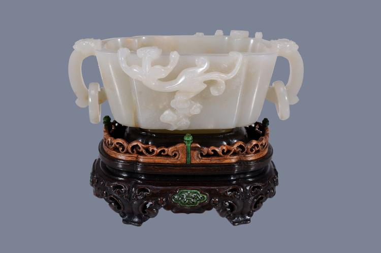 A Chinese white or pale celadon jade two-handled censer , of quatre-lobed form