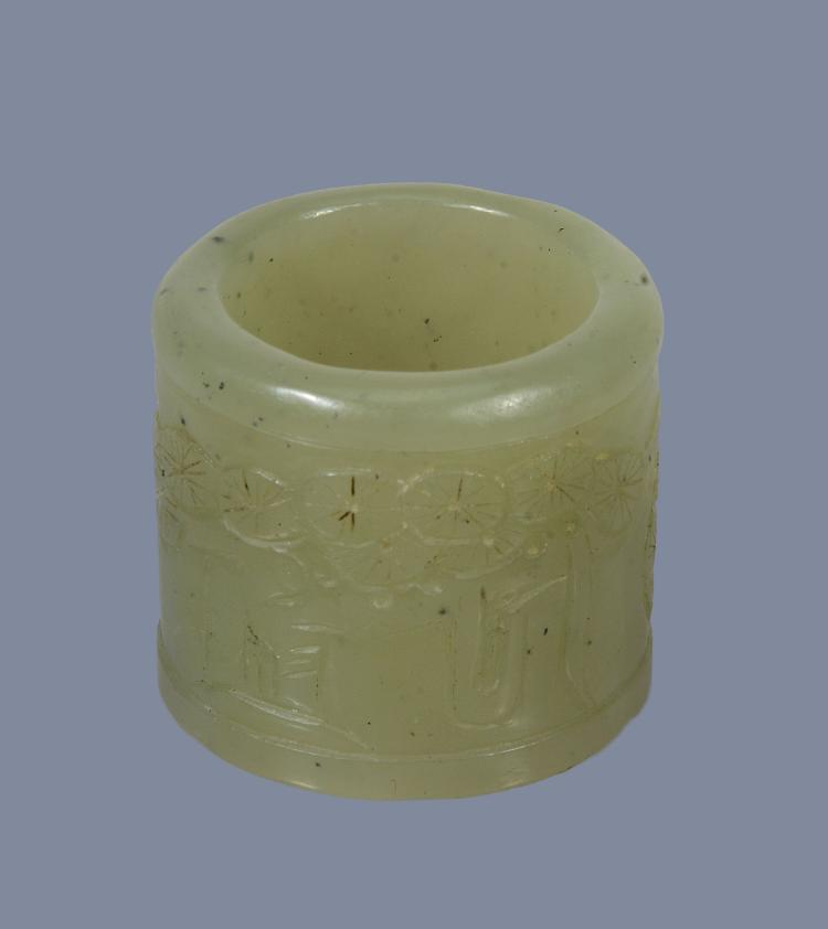A Chinese celadon jade archer's thumb ring, Qing Dynasty, 19th century